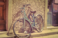 Old bicycle against a rustic wall in Pisa Royalty Free Stock Image