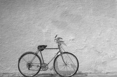 Old bicycle against wall Stock Photo