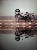 Old Bicycle against a Wall Stock Image