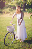 Old bicycle and attractive young woman Stock Photography