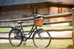 Old bicycle with basket in countryside Royalty Free Stock Photo