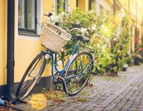 Old bicycle with a basket on an old street background royalty free stock image