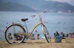 Old bicycle on the beach. Vietnam. Bathing season Royalty Free Stock Photography