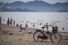 Old bicycle on the beach. Vietnam. Bathing season Stock Images