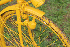 Old bicycle with the bottle dynamo on the front wheel Stock Photos
