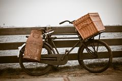 Old bicycle with can and basket. Retro sepia toned horizontal shot stock photos