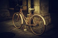 Old bicycle in the city. Ecological transport through the city bike wall vintage retro space transportation wheel street grunge copy nobody style urban cruiser royalty free stock image