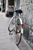 Old bicycle on city street Royalty Free Stock Image