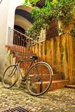 Old bicycle in courtyard Royalty Free Stock Photography