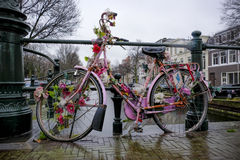 old bicycle decorated with flowers Royalty Free Stock Images