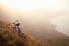 An old bicycle early in the morning in countryside and landscape mist. royalty free stock photo