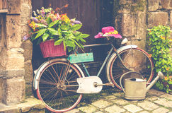 Old bicycle with flowers Stock Photos
