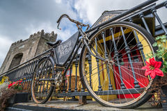 Old bicycle in front of a pub Royalty Free Stock Photo