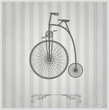 Old bicycle. On a gray background Royalty Free Stock Images