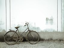 Old bicycle on grunge rustic cement Stock Photography