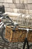 Old bicycle handlebars. Old black bicycle handlebars with wicker case Stock Photo