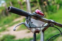 Old bicycle handlebars. In the garden Stock Photography