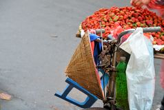 Old bicycle with hat and strawberry Royalty Free Stock Photography