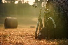 Old bicycle with hay bale with retro effect Stock Photos