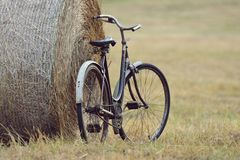 Old bicycle with hay bale with retro effect Royalty Free Stock Image