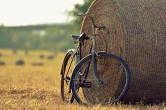 Old bicycle with hay bale with retro effect Stock Images