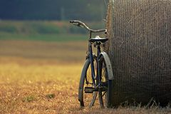 Old bicycle with hay bale with retro effect Stock Photo