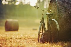 Old bicycle with hay bale with retro effect Royalty Free Stock Photography