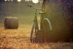 Old bicycle with hay bale with retro effect Royalty Free Stock Photos