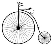 Old bicycle illustration. Illustration of the silhouette of an old vintage bicycle isolated on white background Stock Images