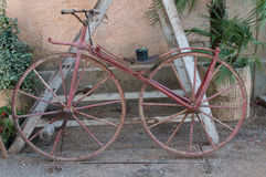Old bicycle with iron wheels stock images