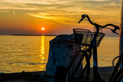 Old Bicycle on Jetty at Sunset Royalty Free Stock Photo