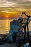 Old Bicycle on Jetty at Sunset Stock Image