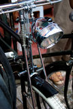 Old bicycle lamp. Old bicycle front with electric lam and pushrod type brakes Stock Images