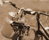 Old bicycle of the last century used to transport the milk by mi Royalty Free Stock Photography