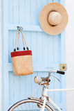 Old bicycle leaning against blue door. royalty free stock photos