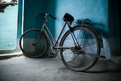 Old bicycle leaning against a wall Royalty Free Stock Image