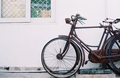 An old bicycle leans against the wall Royalty Free Stock Photo