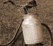 Bicycle milkman with aluminum bin for transporting the milk from. Old bicycle milkman with aluminum bin for transporting the milk from the dairy farm Royalty Free Stock Photo