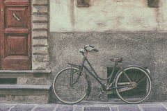 Old Bicycle near the wall Stock Photography