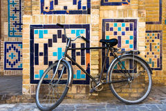 Old bicycle on old street of Bukhara, Uzbekistan. Old bicycle against the wall at ancient building on old street of Bukhara, Uzbekistan Royalty Free Stock Photo
