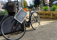 Old bicycle with open sign Royalty Free Stock Images