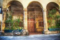 Old bicycle parked by a beautiful loggia in Florence Royalty Free Stock Images