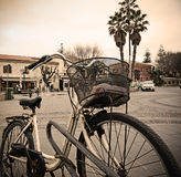 Old bicycle parked in an Italian square Royalty Free Stock Images