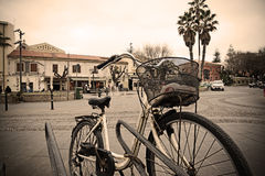 Old bicycle parked in an Italian square Royalty Free Stock Photos