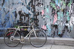 Old bicycle parked and locked in Brooklyn Stock Image