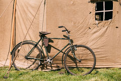Old Bicycle Parked Next To Large Soviet Military Canvas Khaki Tent Stock Photos