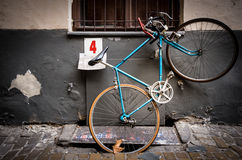 Old bicycle parked in street of Budapest, Europe. Stock Images