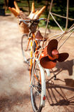 Old bicycle with the propeller and basket full of baguettes stan Royalty Free Stock Photography