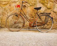 Old bicycle with red bows stock photos