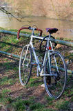 Old Bicycle by the river Stock Photo
